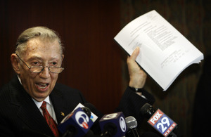 "Richard A. Sprague, defense attorney for State Sen. Vincent J. Fumo, waves a copy of the indictmentat a news conference. Sprague alleges a White House vendetta against ""effective Democrats."""