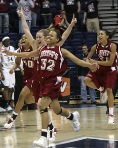 St Joseph's guard Timisha Gomez (32) leads Mary Kate McDade, Brittany Ford (left) and Ayahna Cornish (right) in a charge down the court to celebrate the Hawks' semifinal win at the Cintas Center.