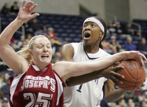 St. Joseph's Jenna Loschiavo (right) battles with Xavier's Joei Clyburn as Clyburn tries a shot during the A-10 championship.