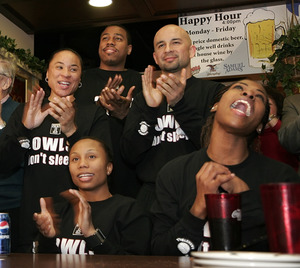 Temple coach Dawn Staley (left, standing), players Fatima Maddox (right) and Ashley Morris, and supporters celebrate after learning of the Owls' seeding at the Draught Horse on Cecil B. Moore Avenue. Story, D6.