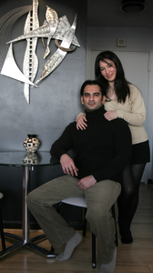 Zaineb Zekeria and her husband, Faizal, in their Center City home. She was born in Chicago; he arrived in the U.S. from Bombay in 1995. They met in 1997 as undergraduates at Temple University.