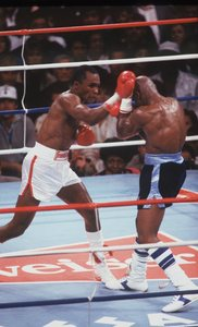 Sugar Ray Leonard throws a punch at Marvin Hagler in an April 6, 1987 bout.