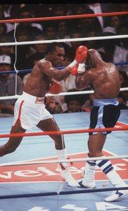 Sugar Ray Leonard throws a punch at Marvin Hagler in an April 6, 1987 bout.