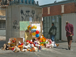 A memorial for Terrence Walker, whose slaying Sunday inspired the vigil, rises under the El in the 6000 blockof Market Street in West Philadelphia. The shooting Tuesday night on the block wounded a woman, 18.