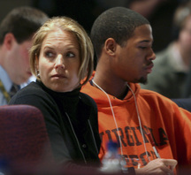 """CBS Evening News"" anchor Katie Couric sits beside Virginia Tech freshman Tim Tutt, 19, of the Collegiate Times. They were in the press room on campus Monday after the massacre of 32 people."