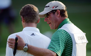 Sean O'Hair is comforted by his caddie and father-in-law, Steve Lucas, on the 18th green during Sunday's final round.