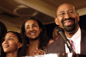Michael Nutter celebrates his primary victory with his wife, Lisa,and daughter, Olivia, 12, on Election Night at the Warwick Hotel. His win is tempered by the number of voters who turned out.