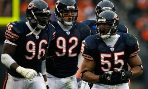 Donovan McNabb for linebacker Lance Briggs? You never know. Briggs (right), shown with Alex Brown (left) and Hunter Hillenmeyer, does not want to return to the Bears, who could be looking for a QB.