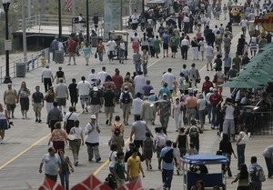 """The Atlantic City Boardwalk was busy yesterday. """"Success or the failure of a summer season is weather-driven,"""" a Shore official said."""