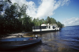 A houseboat, with a motorboat in tow, is a good way to explore the lakes of Voyageurs National Park in northern Minnesota.
