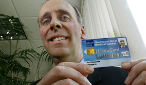 "Joseph Camaratta of Siemens Medical in Malvern with one ofthe firm's ""smart cards"" being tested at a N.Y. hospital system."