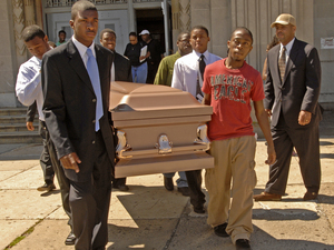 """Lead """"pallbearers"""" Julius Coker (left) and Elisha Morris Jr. (right) bear the casket during a mock funeral held by Dobbins High School students for one of the most hurtful words in the language."""