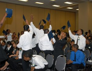 Members of the Sponsor-A-Scholar Class of 2007 celebrate their graduation from high school. Since the program began in 1990, 98 percent of its 710 participants have gone on to college.