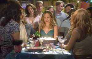 "Roxy (Sally Pressman) blows out her birthday candles in an episode of Lifetime's ""Army Wives"" scheduled for July 15. Pressman, 25, a native New Yorker, was a professional ballerina with the Manhattan Ballet Company. After graduating from Yale, she moved to L.A. to pursue acting."
