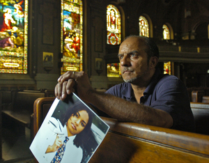 Melvin Figueroa hopes to start a foundation to help find missing people like his murdered daughter, whose picture he holds.