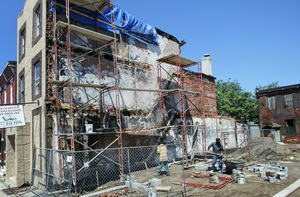 With problem razed, the church wall is stabilized on Thursday.
