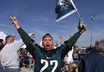 Tailgating at Eagles games is a long tradition, one for which flag-waving fan John Giovinazzo, pictured before a game in 2002, seems to delight in.