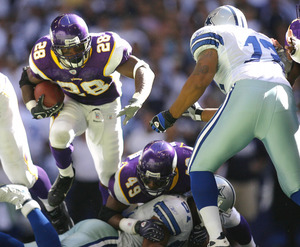 The Vikings' Adrian Peterson , a rookie out of Oklahoma, leads the NFL in rushing with 670 yards in six games.