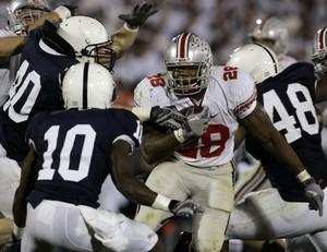 Buckeyes' Chris 'Beanie' Wells finds hole in Penn State defense.