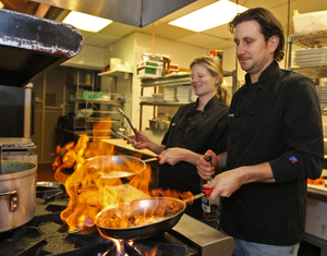Kate Jacoby (left) and Rich Landau in the kitchen at Horizons.