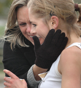 Paige Miller gets a hug from her mother, Sharon, after placing second in the women's division of the Philadelphia Marathon. Miller, who grew up in Ambler, Montgomery County, isa Penn State graduate student.