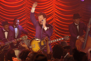 John C. Reilly is Dewey Cox in the spoof, moving from one pop-music idiom to the next over five decades, finally landing in the Rock and Roll Hall of Fame. The movie has fun with every known variety of musical biopic.