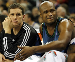 Watching their team fall behind by double digits against Golden State are Minnesota Timberwolves Mark Madsen (left) and Antoine Walker.