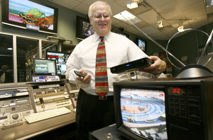 William J. Weber, chief technology officer at WHYY TV12, demonstrates how a digital converter can be attached to old televisions in the WHYY control room. When broadcasting goes digital-only on Feb. 17, 2009, the public will need to be ready. Government coupons will help to defray the cost of converter boxes.
