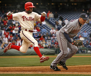 Jimmy Rollins' hustle helped the Phillies avoid their third 0-3 start in as many seasons.