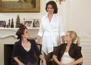 The comedy about an odd female couple linked by the business of surrogacy stars (from left) Tina Fey as the business exec and would-be mother, Sigourney Weaver as director of a surrogacy clinic, and Amy Poehler as the willing surrogate.