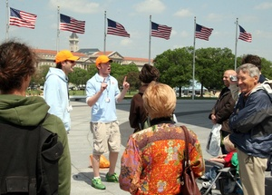 Brody Davis (left) and Ben Hindman , freewheeling founders of DC by Foot, lead a tour group at the Washington Monument.
