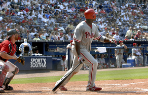 Ryan Howard watches the last of his three doubles bounce off the base of the wall in left, scoring Jimmy Rollins and Shane Victorino in the Phillies´ sweep of the Braves.