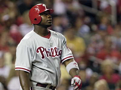 Ryan Howard watches his three-run home run in the sixth inning against the St. Louis Cardinals.