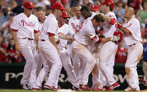 The Phillies celebrate how they always celebrate: by beating the crap out of the guy who won the game.
