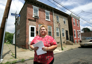 Hilda Vera-Luciano stands in front of her home, now demolished, in Lanning Square. (David Swanson/STAFF PHOTOGRAPHER)