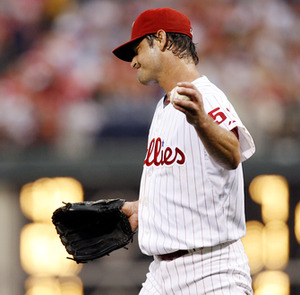 Jamie Moyer reacts after walking Dan Uggla with the bases loaded.