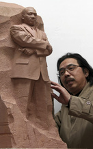 "Sculptor Lei Yixin of China works with a model of the ""Stone of Hope,"" a statue that he created as the centerpiece for the planned Martin Luther King Jr. Memorial."