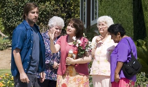 Luke Wilson is a homeowner who wants to be left alone, and Adriana Barraza (center) plays one of the neighbors who won't let him.
