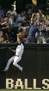 Padres leftfielder Chase Headley can´t catch Pat Burrell´s homer in the seventh inning last night at Petco Park.