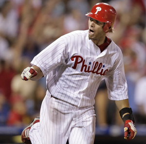 Jayson Werth looks into the Phillies dugout after he homers in the eighth inning last night.