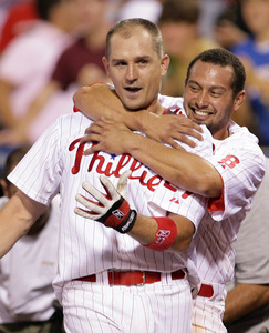 Chris Coste gets a hug from Shane Victorino after Coste singled in Victorino for the game-winning run against the Mets in the 13th.