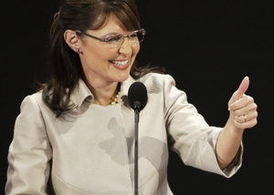 Gov. Sarah Palin gives a thumbs-up to the delegates during her speech Wednesday night.