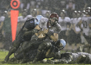 St. Joseph's Prep quarterback Mark Giubilato (with ball) is sacked by North Penn's Andre Poe (7) in the Hawks' loss last week.