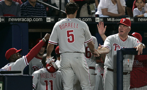 Phillies skipper Charlie Manuel greets Pat Burrell after a two-run home run against Atlanta on Thursday night.