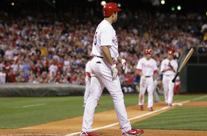 Pat Burrell tosses his broken bat after fouling out with the bases loaded in the third inning.