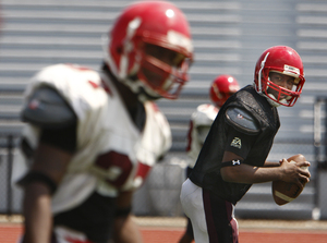 Northeast High quarterback Malik Stokes (right) eyes his brother, receiver Je'Ron Stokes. Together, they're a weapon.