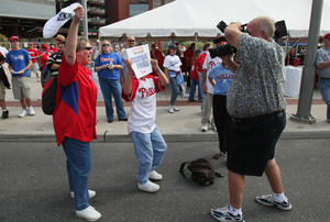 A television photographer gets Phillies fans to cheer on camera.<br />(Jerry Lodriguss / Staff Photographer)<br />