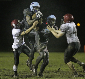 North Penn's Ronnie Akins can catch passes anytime, anywhere. Here he picks one off on defense against St. Joseph's Prep in the Knights' nonleague victory Sept. 12.