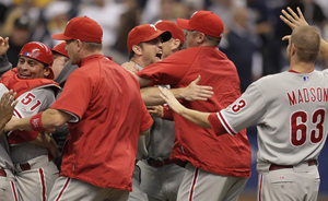 "The Phillies get happy after winning their National League division series. Reaching the NL championship series is a major milestone for homegrown stars Pat Burrell, Cole Hamels, Ryan Howard, Brett Myers, Jimmy Rollins and Chase Utley. ""To be the first team to go this far since '93, it's huge,"" Myers said."