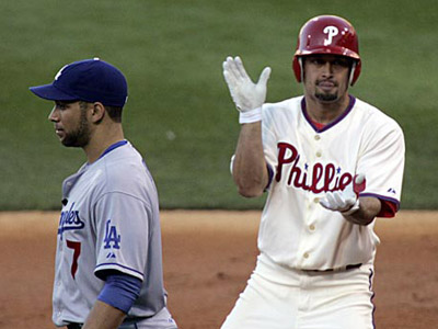 Shane Victorino celebrates his two-run single in the second inning. Brett Myers and Jimmy Rollins scored on the play as the Phils beat the Dodgers, 8-5, for a 2-0 series lead. (Michael Perez / Staff Photographer)